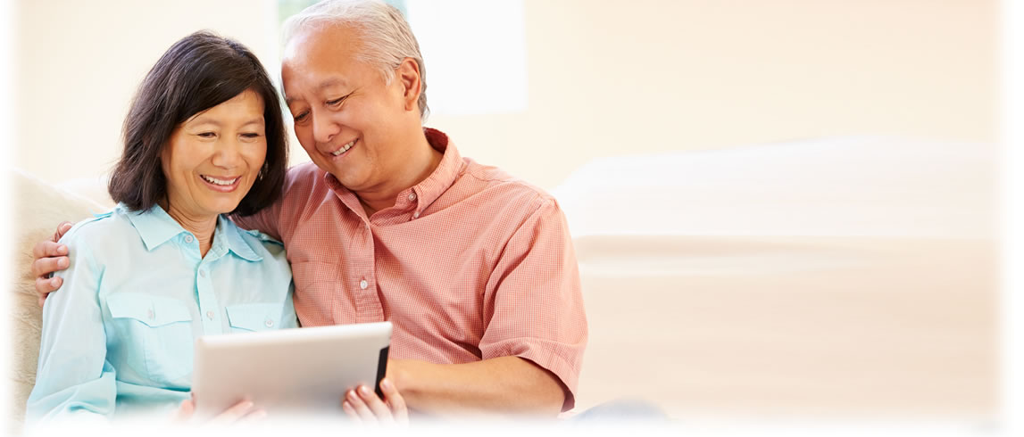 Older couple reviewing tablet information.